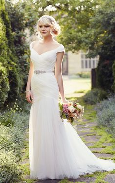 A perfect fit for the sophisticated bride, this whimsical Tulle wedding dress from the Essense of Australia collection features cap sleeves, a low bodice, and layers of soft ruching throughout. The detachable Diamante hand-beaded Grosgrain belt comes in a palette of perfect colors, and the back zips up under sparkling crystal buttons. Adequate boning, a …