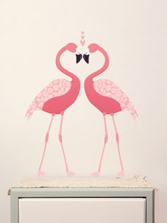 - Description - More Info. - The Brand Let these long legged lovelies add a pink splash to your room. This pair of pretty birds love to be together, but can be positioned however you please. Flamingos