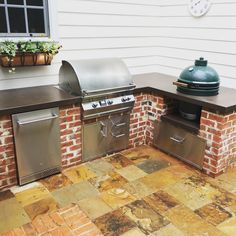 Custom grill island with large big green egg, firemagic grill, delta heat refrigerator and Dekton countertop