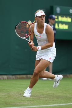 Angelique Kerber preparing to swing her VCORE 100S racquet at 2012 Wimbledon