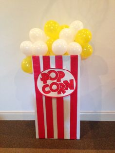Awesome balloon popcorn decoration at a Movie Night birthday party! See more party ideas at CatchMyParty.com!