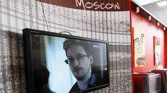 Snowden emerged from weeks of hiding in a Moscow airport Friday, offering to meet President Vladimir Putin's condition that he stop leaking U.S. secrets if it means Russia would give him asylum until he can move on to Latin America.