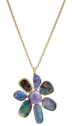 "Opal and Tanzanite Gemma Flower Pendant--   Natural Boulder opal and tanzanite form the shape of a flower for this Gemma pendant, accented with a single station of round diamonds, also on the bail. On a 30"" chain. 18k yellow gold 53.89 cts. t.w. opal 0.20 cts. t.w. diamonds Also pictured: Matching hi/lo Joyce earrings, with 28.61 cts. t.w. opal and tanzanite, and 0.05 cts. t.w. diamonds; $3,075 MSRP      SKU N229YBOPL/TZ / E287YBOPL/TZ     Brand Lauren K     MSRP $9,240.00"