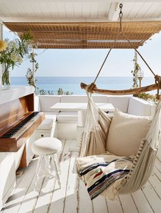 A hammock on the terrace is primed to make the most of views of the sea | http://archdigest.com