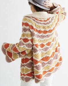 Beautiful huge crochet pattern shells worked in multiple rows are used to transform a simple strand of worsted weight yarn into a vintage, sweater/jacket masterpiece. You will step out in style wearing this cozy, warm, oversized coat. The pattern is easy to follow but the skill level is intermediate. Photo shows the