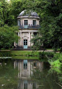 Classical garden folly with blue doors