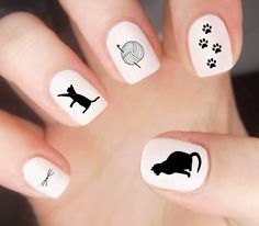 Here, kitty kitty!  Our Black Cat Nail Decal Set features a variety of cat silhouettes along with other cute images like paw prints, whiskers, and a ball of yarn <3
