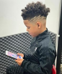 There are something that you might want to consider before selecting the trending boys haircuts, such as the shape of your face and the texture of your hair. Both of these things matter a great deal when you want to kick out these stylish boy haircuts Trending Boys Haircuts, Mixed Boys Haircuts, Black Boys Haircuts Kids, Boys Haircuts Curly Hair, Black Boy Hairstyles, Boys Haircuts With Designs, Hair Designs For Boys, Stylish Boy Haircuts, Boy Braids Hairstyles
