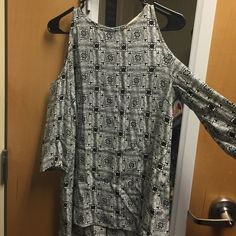 Urban outfitters black and white patterned top Super cute top size small with shoulder cut outs! Barely worn! Looks great with white jeans (see my closet if interested in jeans w/ discount) Urban Outfitters Tops