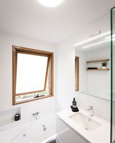 Who says small bathrooms can't have a bath!? An ensuite-sized vanity unit with a narrower depth is perfect for space saving as well as niches for storage. The slim Mizu Bliss looks great here and we love how much light is in this bathroom!