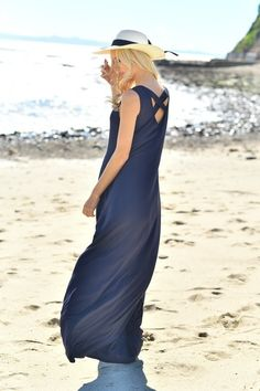 The crossback maxi dress is now available for summer! It is perfect for any occasion, even wearing to the beach. It is available in navy and hot coral.
