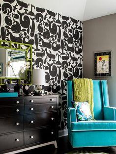 BLACK NURSERY WITH TAUPE WALLS AND BLUE GLIDER -- Interior designer, Karen B. Wolf Interiors.