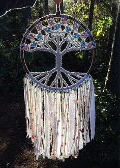 Handmade macrame wall hanging in the 7 Chakra colors. This colorful tree of life adds a colorful touch to the spiritual flow of your home. It can be placed in a window, in the bedroom, or can be used as a personal representation in your meditation/yoga space. This is also a great