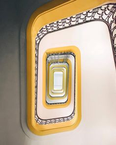 This pop of yellow on these stairs draws the eye up up up! #InteriorDesign