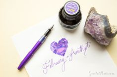 Love this purple fountain pen and ink! February's birthstone is amethyst and is represented by a Pilot Metropolitan Retro Pop Purple fountain pen and Monteverde Amethyst ink. Read this blog to find more fantastic pen and ink birthstone matches! Pin for later.