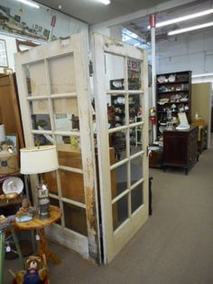$295 - Vintage French Doors hinged and sold as a pair. White chippy paint. Great for D.I.Y. Projects. ***** In Booth A6 at Main Street Antique Mall 7260 E Main St (east of Power RD on MAIN STREET) Mesa Az 85207 **** Open 7 days a week 10:00AM-5:30PM **** Call for more information 480 924 1122 **** We Accept cash, debit, VISA, Mastercard, Discover or American Express