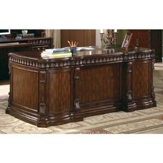 Coaster Fine Furniture 800800 Executive Desk with Computer Storage by Coaster Home Furnishings. $1064.33. Wire management holes for easy electrical access. Felt lined top drawer. Large table top has an inset leather panel. This Coaster traditional executive double pedestal desk is constructed of durable wood in a warm Rich Brown finish, featuring a grand scale for a regal look. The desk features spacious storage drawers in each of the two pedestals and top drawers have bee...