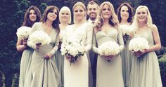 The bridesmaids are in long, light teal Stella McCartney dresses. The two maids of honor (pictured on either side of the bride) wore dresses that have embroidery details similar to those on the bride\'s wedding dress.
