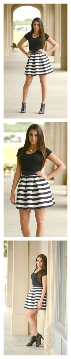 """Adorable colorblocked skirt. Length: 18.5"""". 95% Polyester, 5% Spandex. Imported."""
