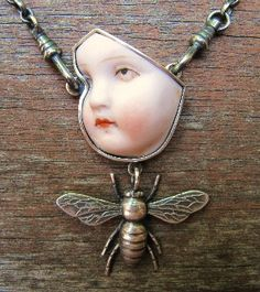 cracked doll head | Pendant – broken porcelain dolls head, cast silver