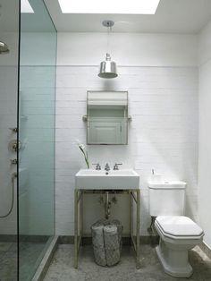 towels in basket; sink; doorless shower: Remodelista
