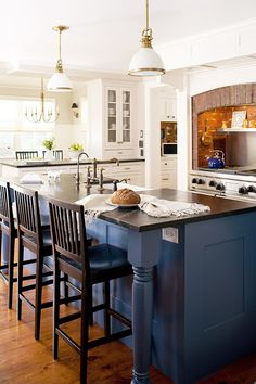 Our Most Beautiful Kitchens - Traditional Home®....brick surround and contrasting blue island!