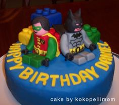 Lego Batman cake - I made this cake for my son's sixth birthday, at his request - he loves the Lego Batman game on the Wii. I used MMF to cover the cake and the legos (rice crispy treats), bit it was too soft for Batman and Robin - they kept collapsing and their edges were all squishy. I had to buy a package of Wilton's rolled fondant at the last minute and sculpt them out of that. Next time I'll just make the figures out of gumpaste!