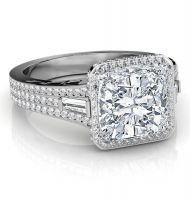Make this beautiful diamond engagement ring a symbol of your commitment to your loved one! It features a brilliant 1.51 Ct. Cushion cut diamond with 100% eye clean SI1 clarity and H color grade. Surrounding the center gem and along the shank in 3 rows are 1.05 Ct. micro pave Round cut diamonds. Baguette cut diamonds are placed on each side (0.25 Ct. total weight) in channel set balancing the entire piece with supreme elegance. These side diamonds have G-H color grade and VS2-SI1 clarity…
