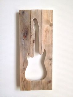You can buy this guitar cut from reclaimed wood on Etsy, for $60.00, or use the piece that you cut out the guitar for the other project for less money..!!