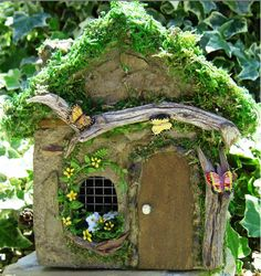 Love this butterfly themed house - hardware cloth makes nice window pane dividers, driftwood trim, window box is SO cute, love the tiny flowers, moss is nice to set off roof, and the flagstone style front - inspiration only   **********************************************  Enchanted Garden - #fairy #garden #house #miniature #miniatures #gardening #whimsy #whimsical #DIY #crafts - tå√