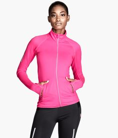 Neon pink jacket in fast-drying, functional fabric. Ventilating mesh panels, zip pockets, and reflective details. | H&M Sport