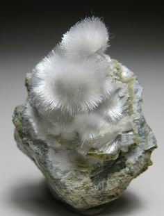 Artinite: magnesium/ carbon. Environment: Low-temperature hydrothermal mineral in veins & crusts in serpentinized ultra basic rocks. California