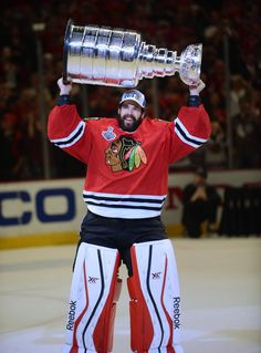 Chicago Blackhawks goalie Corey Crawford lifts the Stanley Cup Monday in the Stanley Cup Final Game 6 at the United Center in Chicago.