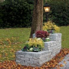 Gardening - Stack cast-concrete blocks in a tiered pattern to give your curb appeal a hefty boost. PICK THIS PROJECT! See the DIY tutorial. Brick Planter, Stone Planters, Garden Planters, Mailbox Landscaping, Garden Landscaping, Landscaping Ideas, Driveway Entrance Landscaping, Driveway Ideas, Landscaping Software