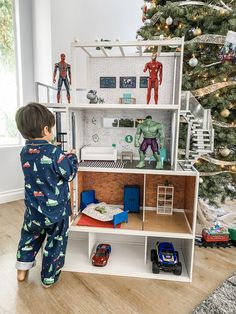 My sons Hero HQ! Converted from a Barbie doll house. Doll House For Boys, Doll House Play, Toy House, Barbie Doll House, Boy Barbie Dolls, Diy Cadeau, Wooden Dollhouse, Toy Rooms, Diy For Kids
