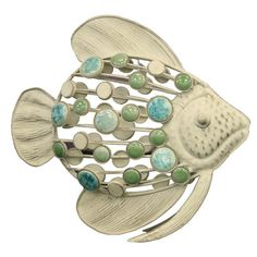 Weathered metal fish decor with multicolor mosaic accents.  Product: Fish décorConstruction Material: Iron and ...