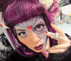 ♥ La Carmina in Gothic Beauty Magazine! ♥     My sugar skull makeup & Lolita dress... possibly my FAVORITE photoshoot yet.     What do you think? It would be awesome if you can support my team with a Like/Share. :)     http://www.lacarmina.com/blog/2012/07/la-carmina-in-gothic-beauty-magazine-mexican-sugar-skulls-makeup-purple-extensions-hairstyle-lolita-dress/