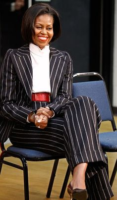 First Lady Michelle Obama wearing an Alexander McQueen suit.