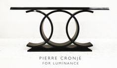 This design for this server was inspired by the iconic Chanel logo. Custom designed by Pierre Cronje for Luminance in French Polished Mahogany