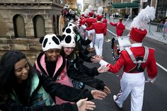 Panda performers from the float 'China's Chengdu - Home of the Giant Panda' greet others as they await the start of the Macy's Thanksgiving Day Parade in New York