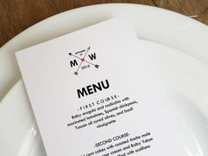 A printable menu template from e.m.papers featuring criss-crossed arrows and a wedding monogram. Simply download and print the editable PDF file.