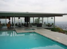 Case Study House No. 22 - The Stahl house.  This is one of the world's most famous houses, along with Falling Water.  Designed by Pierre Koenig, it hangs over the Hollywood Hills. It was built in 1959 as part of the Case Study program, which  commissioned major architects of the day to advance American architecture.