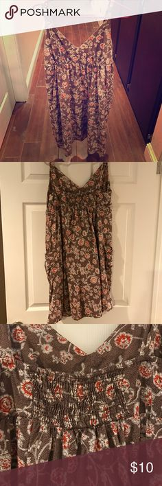 Women's mossimo large dress with pockets Women's Mossimo brand brown dress with red flowers. Two pockets on the sides. I bought it for a luau in Hawaii and only wore it once. I'm 5'6 and it sits just above my knee. Very cute and good condition Mossimo Supply Co. Dresses Midi