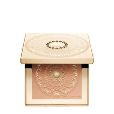 Odyssey Face Palette. Clarins' shimmering, lightweight pressed powder brings a goddess glow to face, neck and décolleté. Matte gold medallion compact—with engraved edges, scrolls and golden mother-of-pearl—is the must-have holiday accessory for all skin tones.