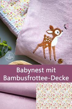 """Aelas hat aus unserer Bio-Baumwolle """"Streublumen maxi"""" und dem kuschelweichen Bambus-Frottee genäht. Während das Reh in diesem Fall gestickt ist, ist das Babynest ein tolles Nähprojekt für Nähanfänger. Bath Mat, Home Decor, Baby Nest, Deer, Bamboo, Cuddling, Fabrics, Breien, Cotton"""