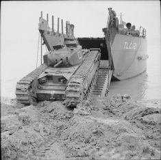 A Churchill tank leaves a tank landing craft (TLC 121) during a combined operations exercise at Thorness Bay on the Isle of Wight, 27 May 1942.