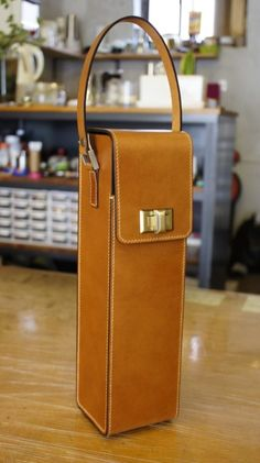 aesopica - leather wine carrier