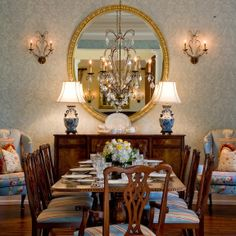 Love the Lamps, wallpaper, fabric on wingchairs and dining chairs, also the furniture, mirror and scones.  Did I leave anything out.      Kahn Design Group | Portfolio