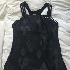 Nike Sports Tank with Bra This black and white patterned sports tank from Nike is in Like New condition. It has a built in bra for your convenience. It's the perfect addition to your workout wardrobe! I'm open to offers :) Nike Tops Tank Tops