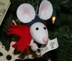 Recycled xmas light bulb into mouse ornament.